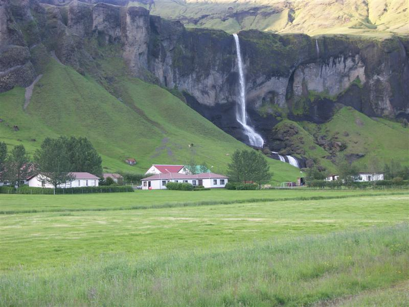Iceland One of many waterfalls along the coastal route.jpg